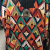 Φαρδιά μπλούζα εμπριμέ τύπου Πόντσο
